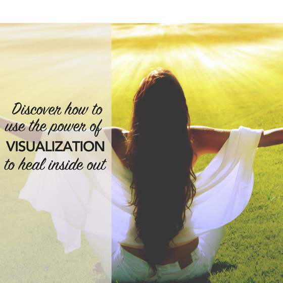 Woman sitting on the grass with open arms using the power of visualization