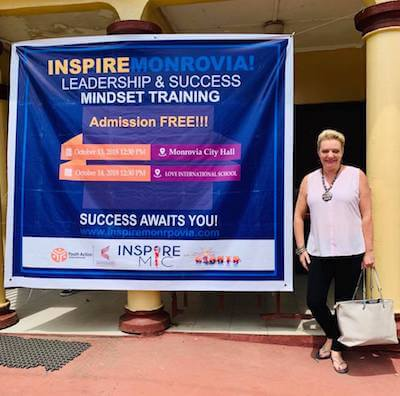Natalie Ledwell with the Inspire Monrovia banner