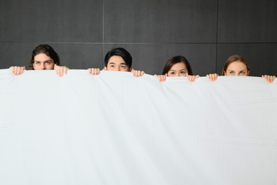 4 People Hiding Behind a Sheet