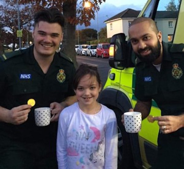 Little girl with two paramedics