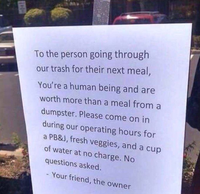 Sign on restaurant door offering free meal