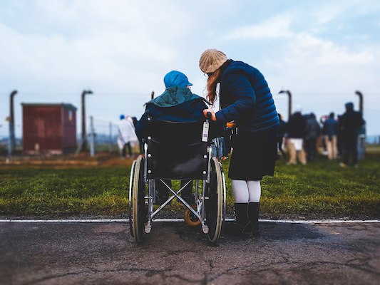 Woman with Older Person in Wheelchair