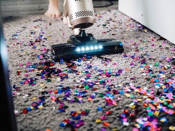 Person Vacuuming Confetti