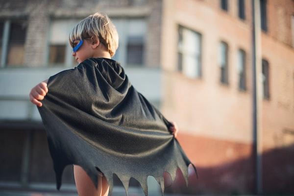 Little Boy Wearing Superhero Cape
