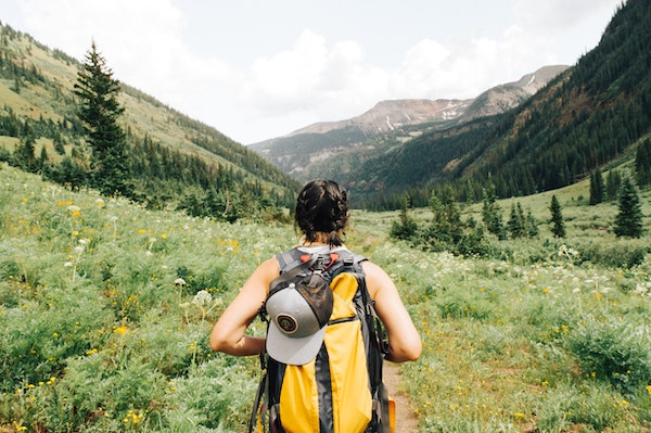 Woman Backpacking in Mountains