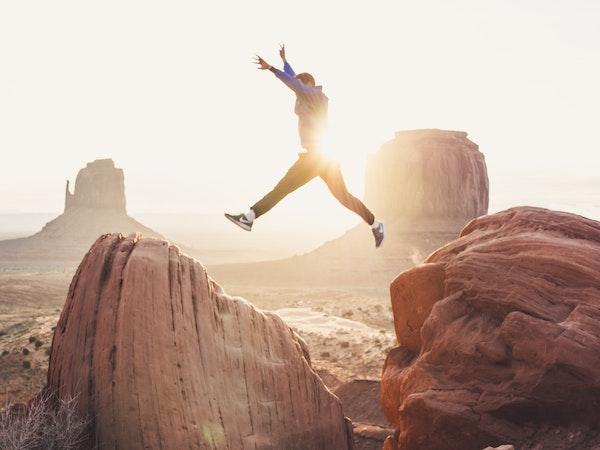 Man Leaping Between Rocks
