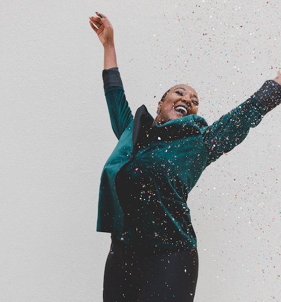 Happy Woman Jumping with Confetti