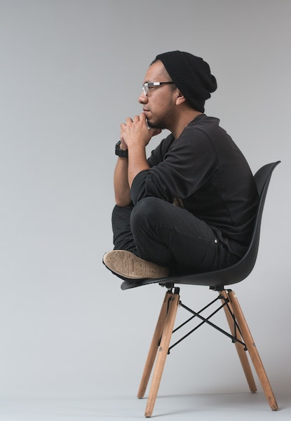 Man Thinking While Sitting in a Chair