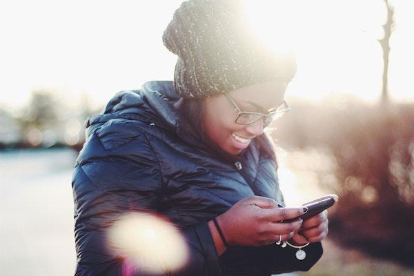 Happy Woman Looking at Phone