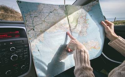 Woman Looking At Road Map