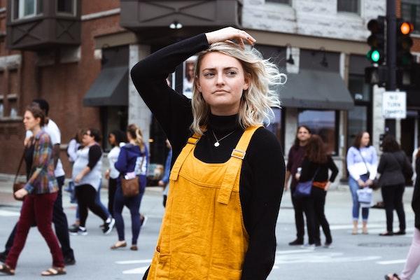 Women Thinking on Busy Street