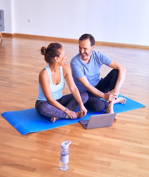 Couple Sitting on Yoga Mat