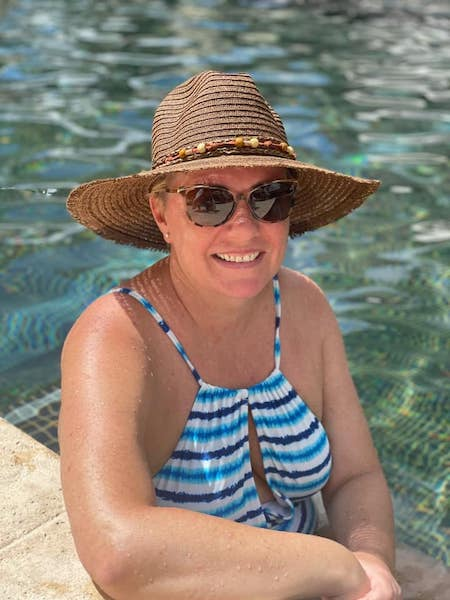 Natalie Wearing a Hat by the Pool