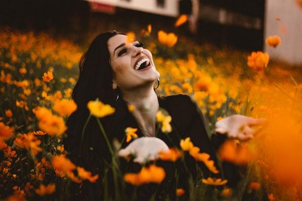 Smiling Woman in Flower Field